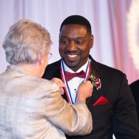 Governor Ivey presents Antonio Langham with his ASHOF Medal