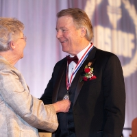Governor Ivey presents Daniel Moore with the Distinguished American Sportsman Award