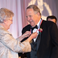 Governor Ivey presents Bill Burgess with his ASHOF Medal