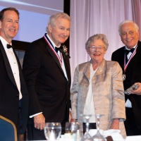 Board Member Marc Tyson, Bud Moore, Governor Kay Ivey and Chairman Edgar Welden