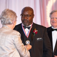 Governor Ivey presents Tommie Agee with his ASHOF Medal